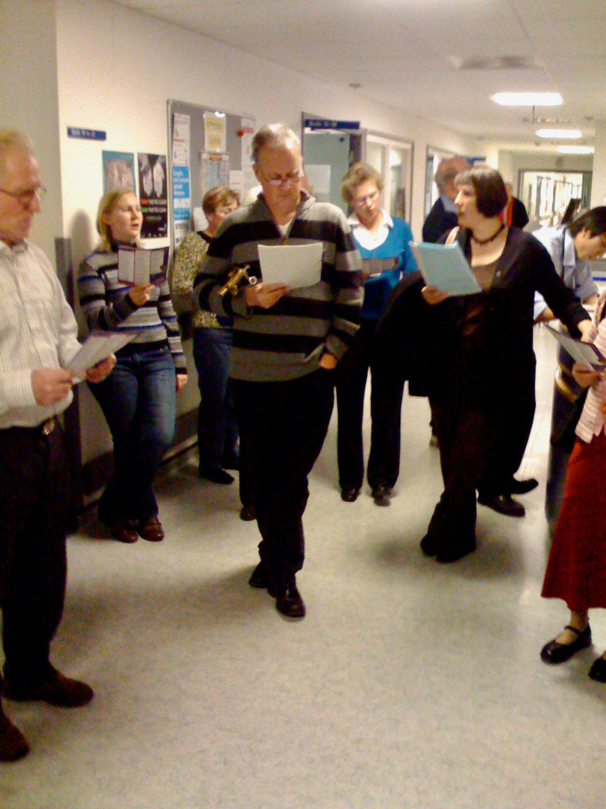 Carol singing in the wards of St George's hospital, Tooting.