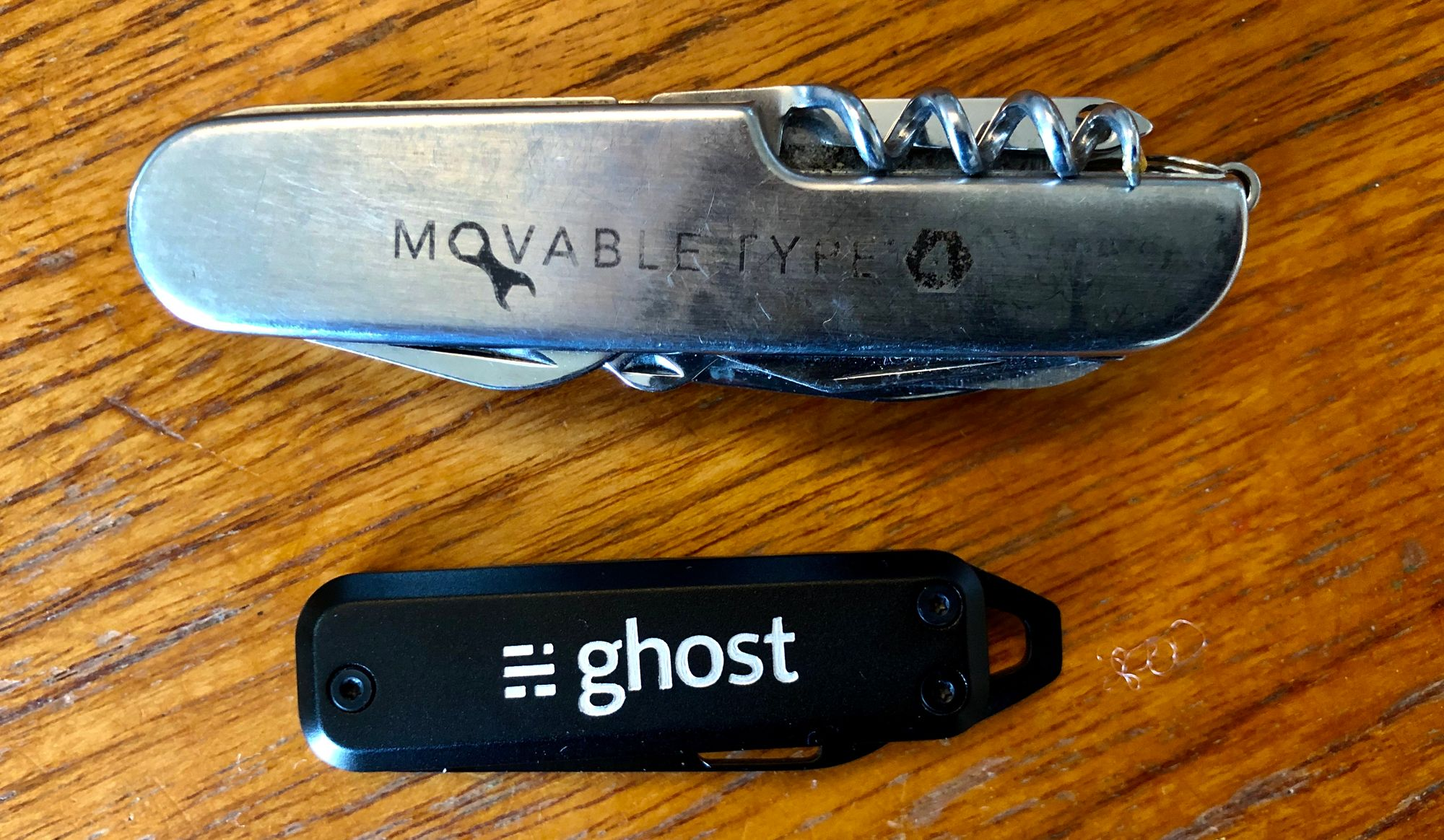A Movable Type penknife above a Ghost penknife.