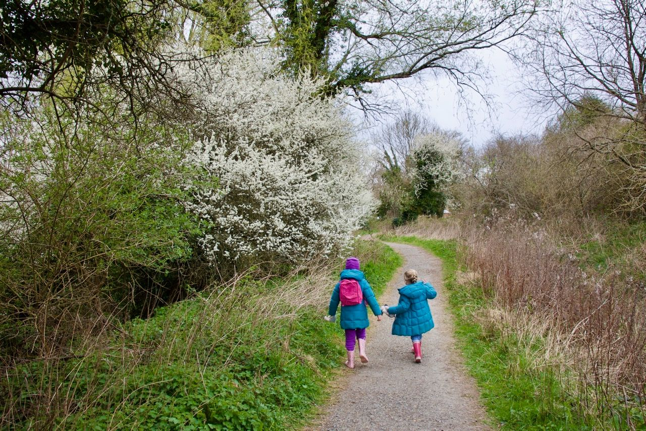 Two girls walking on a path at Woods Mill nature reserve