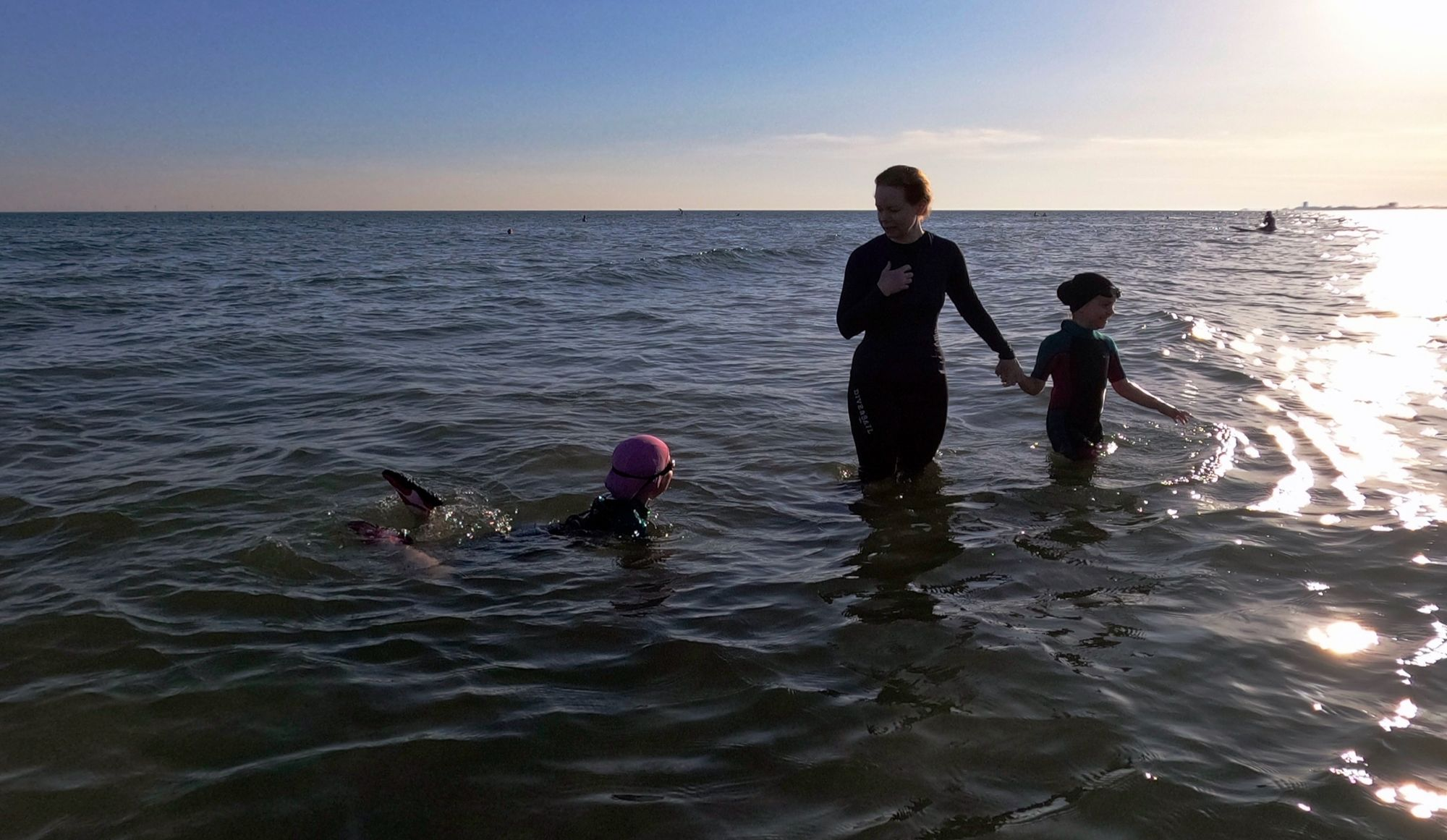 A mother and her daughters in the sea off the Sussex coast.